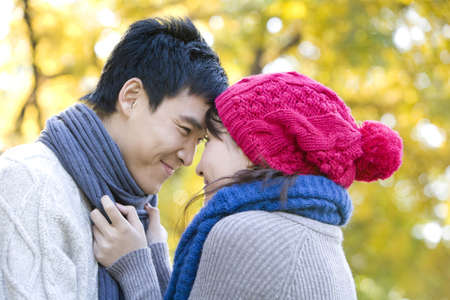 Young Couple Enjoying a Park in Autumn LANG_EVOIMAGES