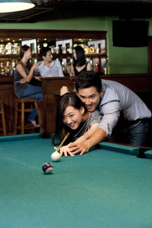 over the counter: Couple Playing Pool Together LANG_EVOIMAGES