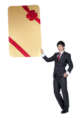 oversized: Excited Businessman Holding an Oversized Wrapped Card