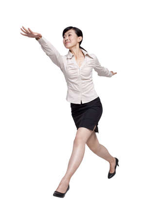 legs apart: Excited Businesswoman Jumping LANG_EVOIMAGES