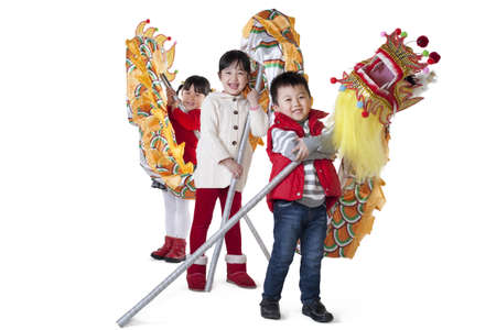 Three Chinese children holding Chinese dragons