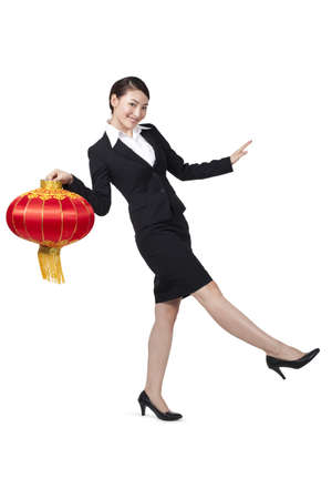 legs apart: Happy Businesswoman Holding a Chinese Lantern LANG_EVOIMAGES
