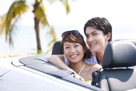 transportation: Couple Sitting in the Back Seat of a Convertible