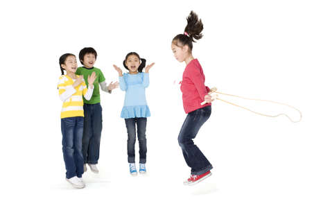 cheer full: Friends cheering their friend as she jump ropes LANG_EVOIMAGES