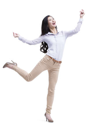 Cheerful young woman standing on one leg