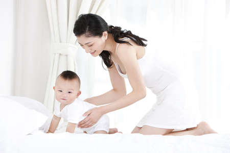 Chinese mother and lovely baby boy at home