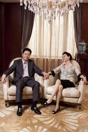 Senior couple sitting in a luxurious room