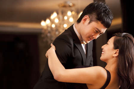 Young couple dancing in a luxurious room LANG_EVOIMAGES