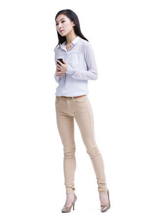 Young woman with mobile phone in hand LANG_EVOIMAGES