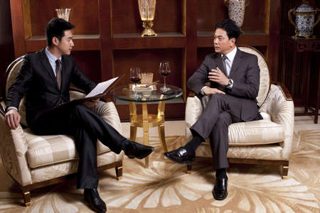 suite: Businessmen in a meeting in a luxurious room