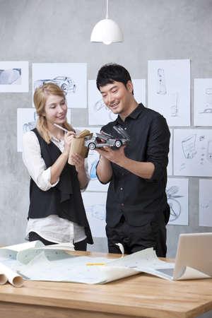 joy pad: Car designer and assistant at work