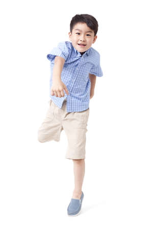 legs apart: Boy jumping with excitement