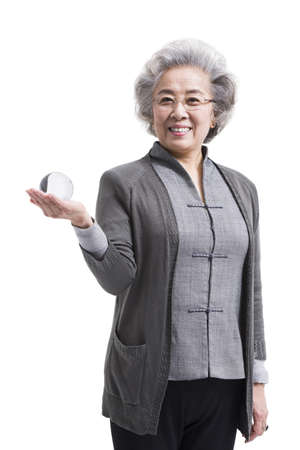 heart intelligence: Senior woman with crystal ball LANG_EVOIMAGES