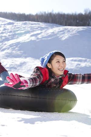 hebei: Happy young woman having fun in ski resort LANG_EVOIMAGES