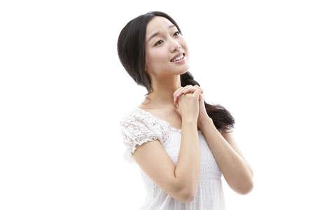 Young woman praying LANG_EVOIMAGES