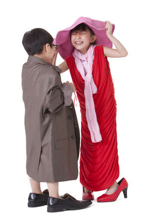 girl in full growth: Boy and girl dressing up like adults