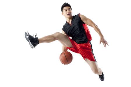 legs apart: Man jumping doing basketball tricks