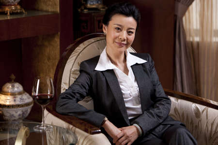 Mature businesswoman in a luxurious room LANG_EVOIMAGES