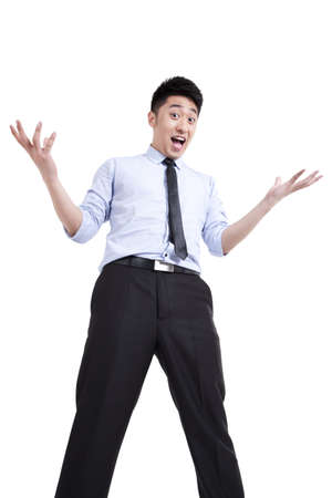 legs wide open: young businessman with surprised look on face