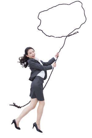 Businesswoman holding rope bubble LANG_EVOIMAGES