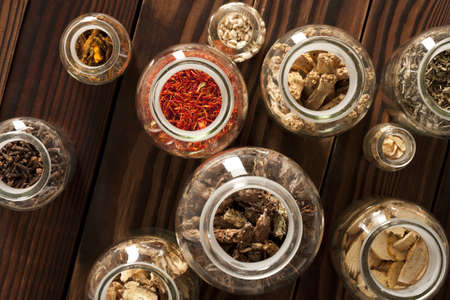 plantain herb: Various Chinese medical herbs in jars LANG_EVOIMAGES
