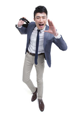 Happy businessman shouting LANG_EVOIMAGES