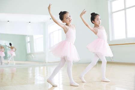girl in full growth: Little girls practicing ballet