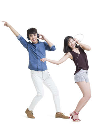 legs apart: Happy young couple listening to music