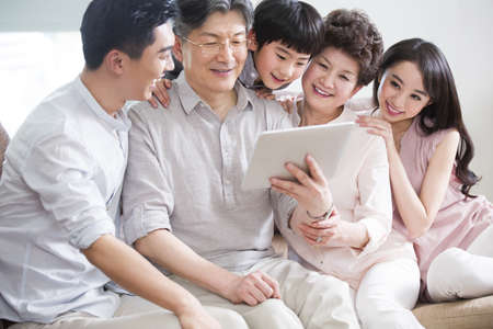 Happy family with digital tablet