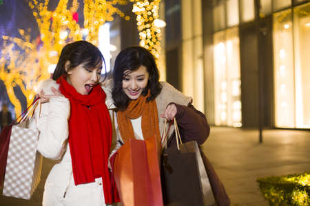 Happy young women shopping for Chinese New Year