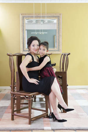 legs crossed at knee: Happy mother and daughter