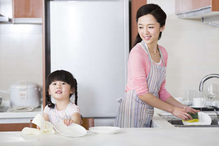 refrigerator: Mother and daughter washing dishes LANG_EVOIMAGES