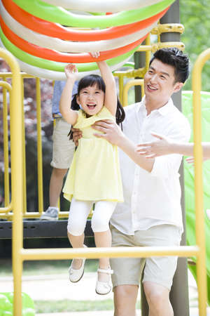 Father and daughter playing in amusement park