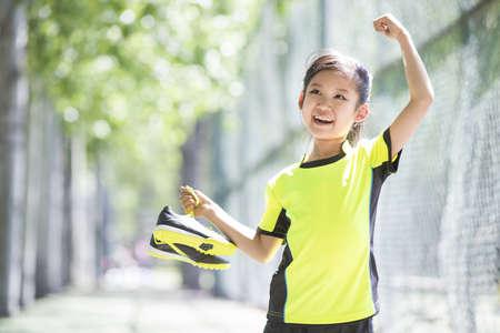 Happy girl in sportswear cheering