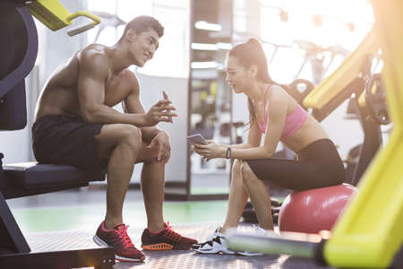Young couple resting at gym