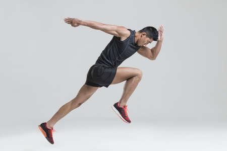 legs apart: Male athlete running