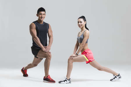 Young couple exercising LANG_EVOIMAGES