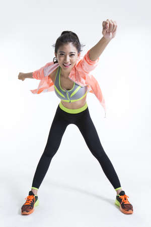 Cheerful young Chinese female athlete
