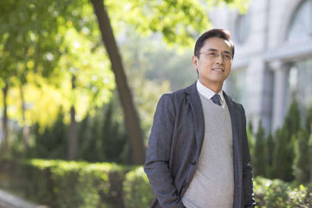 Confident Chinese businessman looking at view