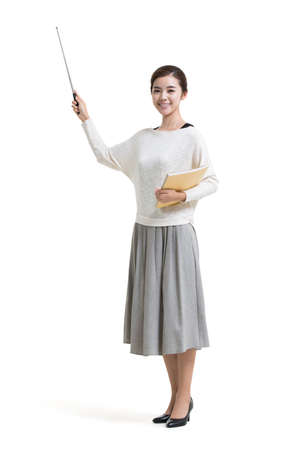 Young female Chinese teacher holding teachers pointer