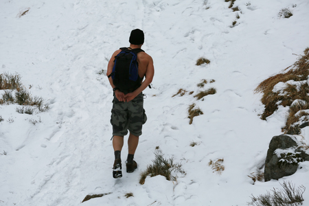 Extreme climb to the mountains on a frosty day