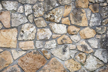 A wall of natural stone as an interesting and attractive background to the design