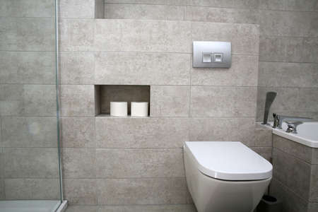 A white washbasin with a tap in a modern apartment