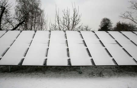 Photovoltaic panels covered with snow on a snowy day