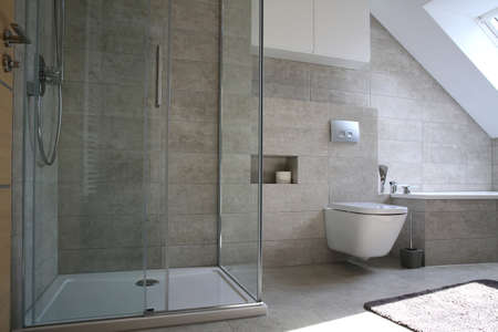 A Modern Bathroom in Gray Colors In A Simple Style