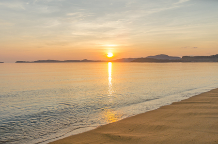 Sunrise behind mountain at bophut beach samui island thailand photo
