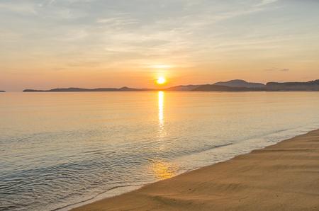 Sunrise behind mountain at bophut beach samui island thailand photo