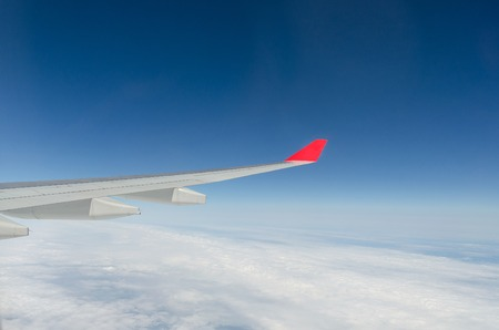 aeroplane: Wing of airplane flying above the cloud