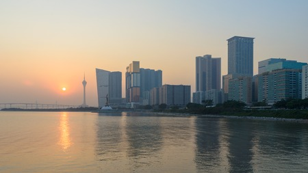 maintains: Macau, China - Jan 8, 2013: Skyline of macau city at outer harbour before sunset. The city maintains the worlds highest gambling revenue