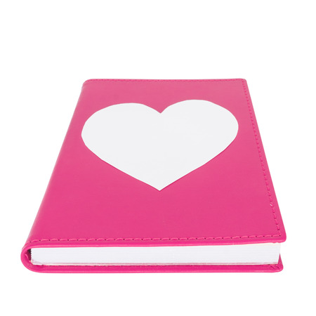 leatherette: Paper heart on pink book isolated on white background ,selective focus